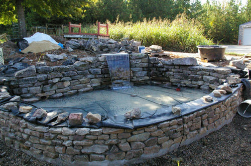 Start Of Raised Pond With Patio And Bench