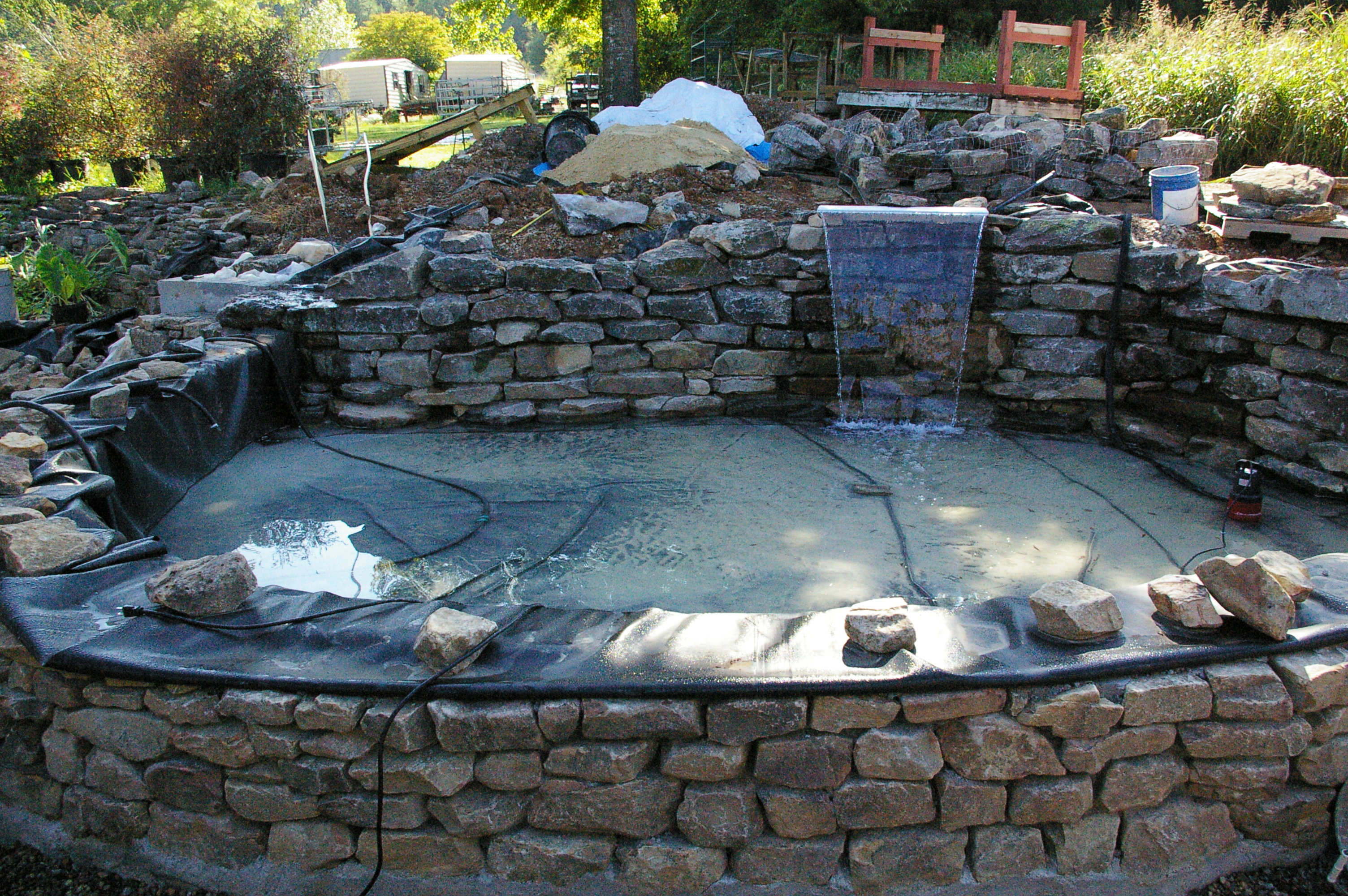 Raised Outdoor Pond : Start of raised pond with patio and bench